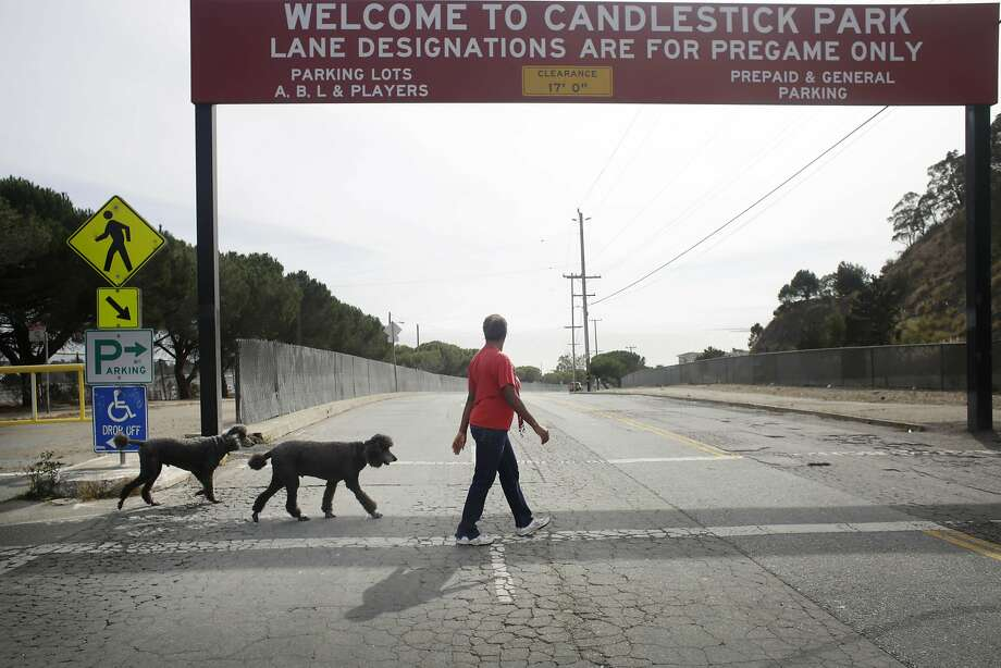 Shirley Moore, member of the Bayview Hill Neighborhood Association, Candlestick Point Neighborhood Committee chair and Clear Air Health Alliance president, walks her dog along Jamestown Avenue  on Friday, October 23,  2015 in San Francisco, Calif. Photo: Lea Suzuki, The Chronicle