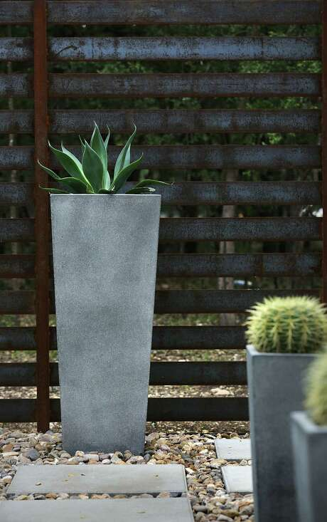 Plants, planters, fences and all other elements of a landscape design can be chosen to suit any architectural style, and the diverse palette of drought-tolerant plants provides enough options for any look. Photo: Bob Owen /San Antonio Express-News / San Antonio Express-News
