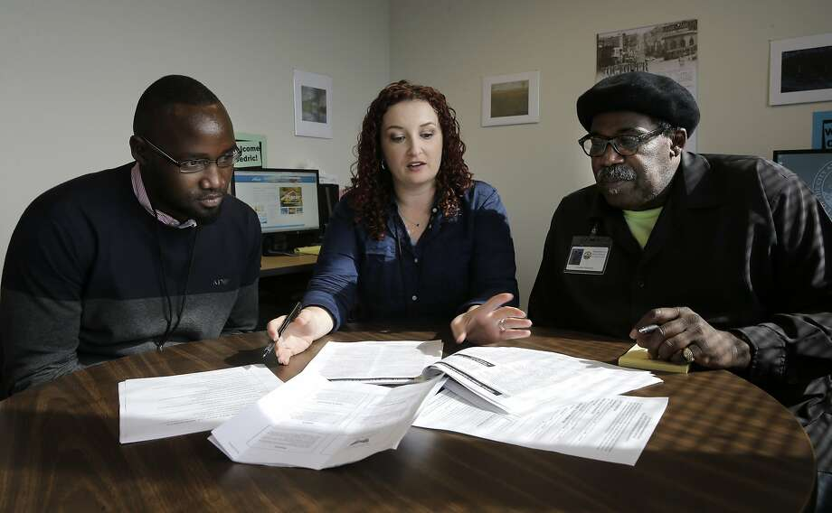 Cedric Fotso,(left) the peer specialist, Director Angelica Almeida and Charles Houston, the family liaison, the staff of the Assisted Outpatient Treatment program, at their offices in San Francisco, Calif., during a training session on Fri. October 23, 2015. The center is scheduled to open on Nov. 2nd. Photo: Michael Macor, The Chronicle