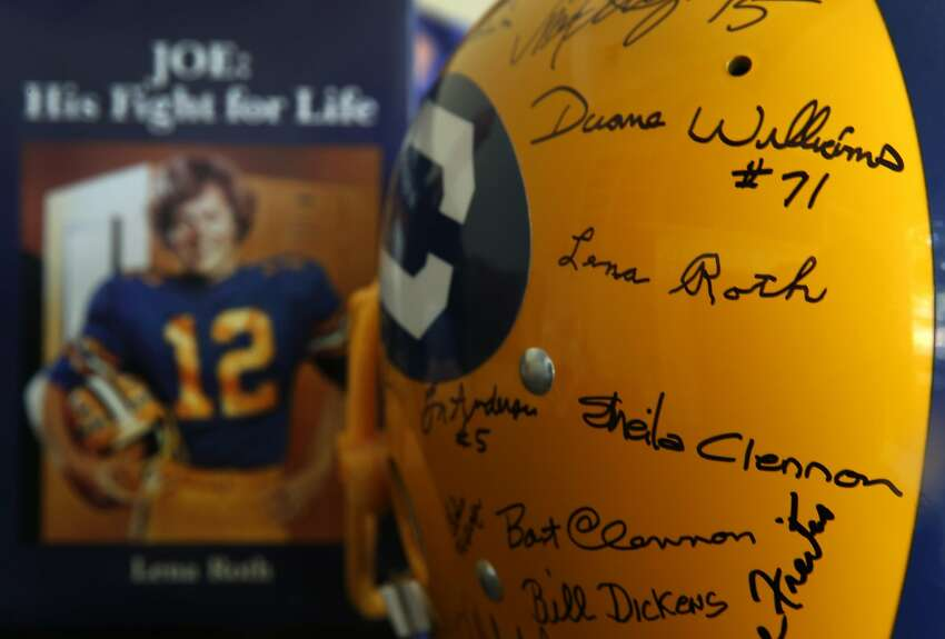 A Cal helmet signed by friends and family - including Joe Roth's mother, Lena, who appeared in the documentary about the late Cal Bears quarterback - sits next to a copy of the book that Lena Roth published about her son.