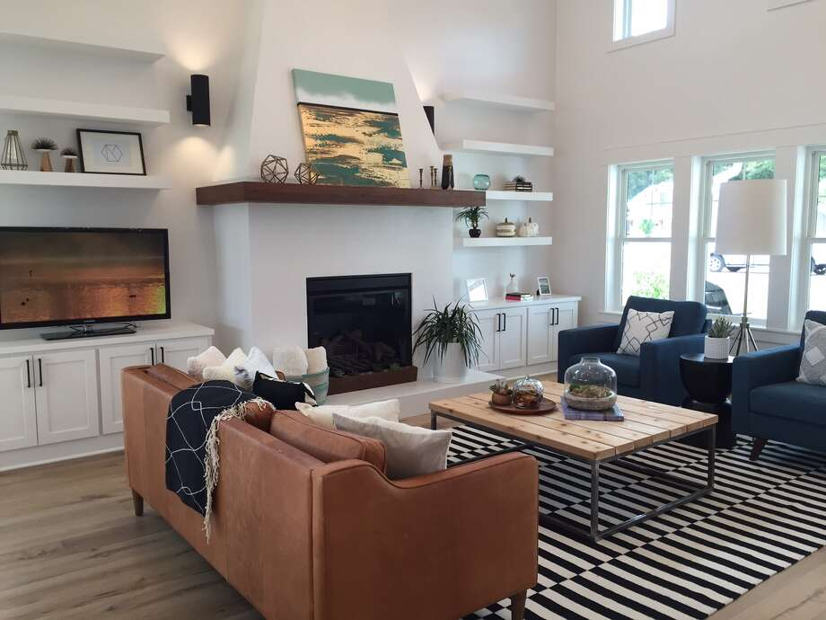 A modern farmhouse near the heart of Fredericksburg includes a walnut mantel on the plaster fireplace and 20-foot vaulted ceiling in the living room. The house by Hominick Custom Builders is one of nine featured on the 2015 Hill Country Builders Parade Home Tour. Directions to the houses and more information about the tour, including changes because of weather, can be found at HillCountryBuilders.org. Photo: Courtesy Photo