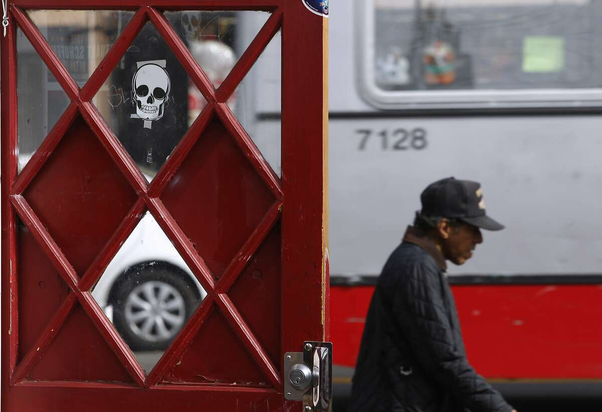 A man walks past the open door of a restaurant at Mission and Sycamore streets in San Francisco, Calif. on Friday, Oct. 23, 2015.