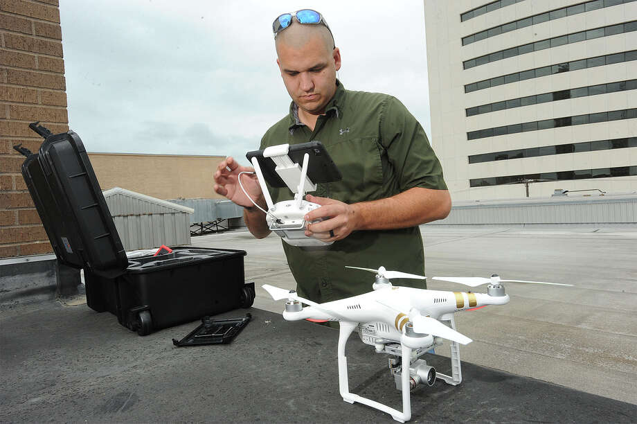 Michael Wirfs prepares his drone for flight in Beaumont on Thursday.
