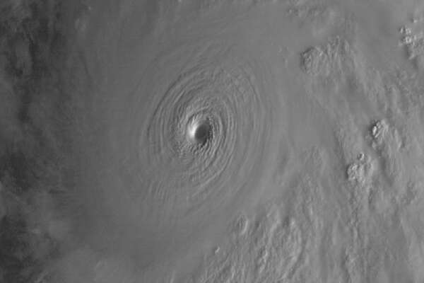 """This satellite image taken at 9:30 a.m. EDT on Friday, Oct. 23, 2015, and released by the National Oceanic and Atmospheric Administration shows Hurricane Patricia. Hurricane Patricia headed toward southwestern Mexico Friday as a monster Category 5 storm, the strongest ever in the Western Hemisphere that forecasters said could make a """"potentially catastrophic landfall"""" later in the day.  (NOAA/RAMMB/CIRA via AP)"""