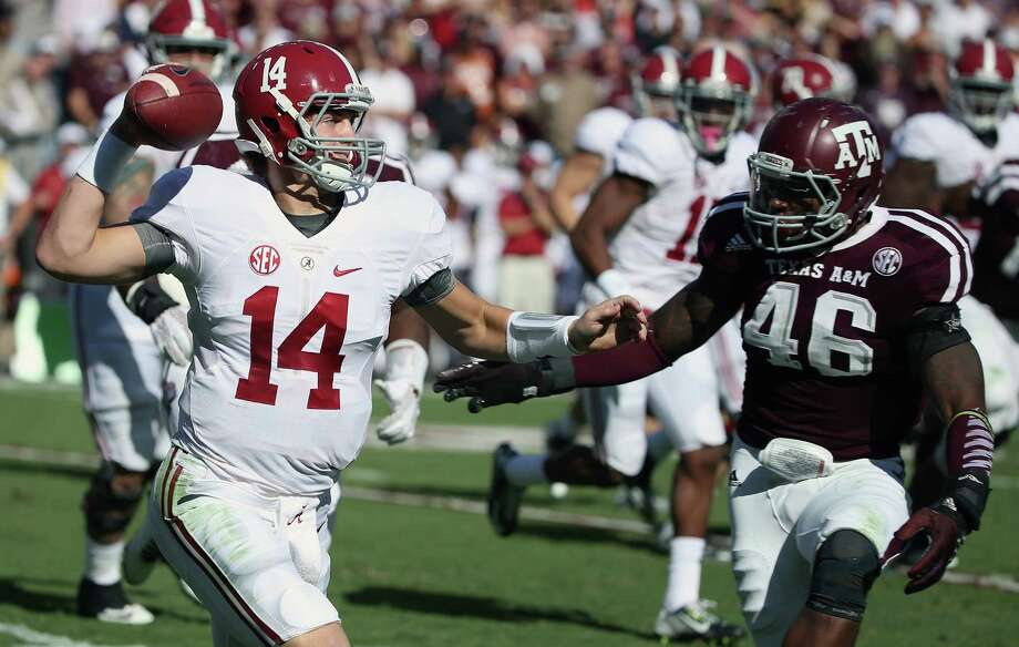 Quarterback Jake Coker of the Alabama Crimson Tide looks to throw a pass as A.J. Hilliard of the Texas A&M Aggies defends in the first half of their game at Kyle Field on Oct. 17, 2015 in College Station. Photo: Scott Halleran /Getty Images / 2015 Getty Images