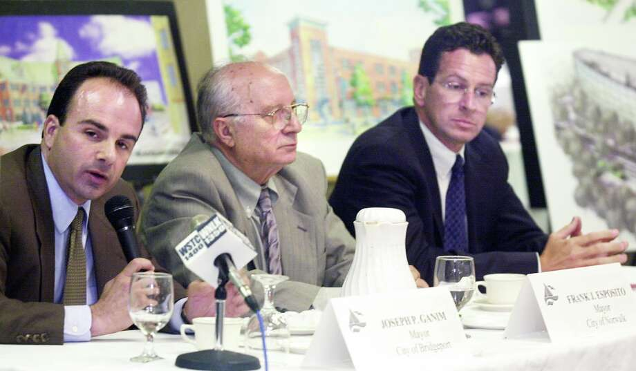 Then-Bridgeport Mayor Joseph P. Ganim, left, and then-Stamford Mayor Dannel P. Malloy, right, at a luncheon in Norwalk in 2001. Between them is Frank Esposito, mayor of Norwalk at the time. Photo: File Photo