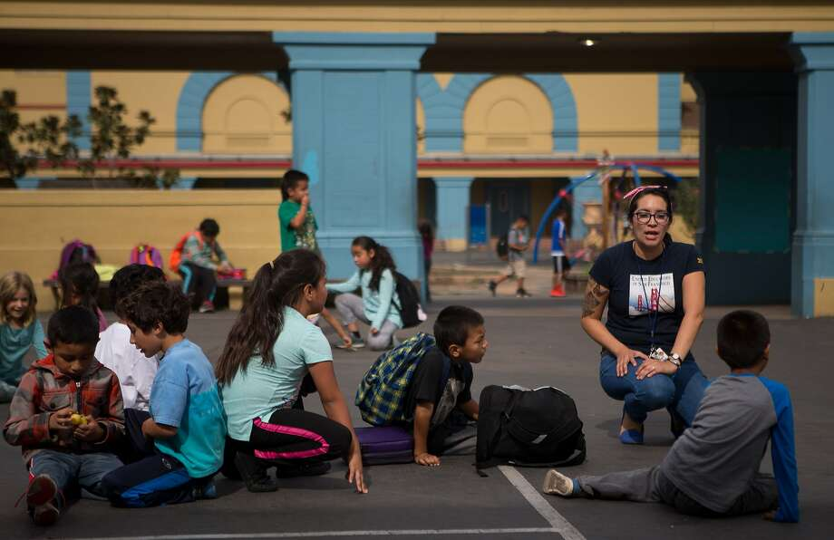 Maribel Chavez, a teacher at Buena Vista Horace Mann grade school in the Mission district, lines up her students after lunchtime recess on Friday, Oct. 23, 2015 in San Francisco, Calif. Photo: Nathaniel Y. Downes, The Chronicle