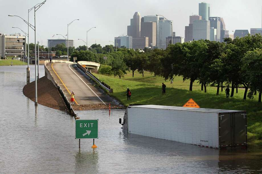A tractor trailer is seen with the Houston Skyline in the background in the flood waters on 288 and McGregor. Photo: Thomas B. Shea, Freelance / © 2015 Thomas B. Shea