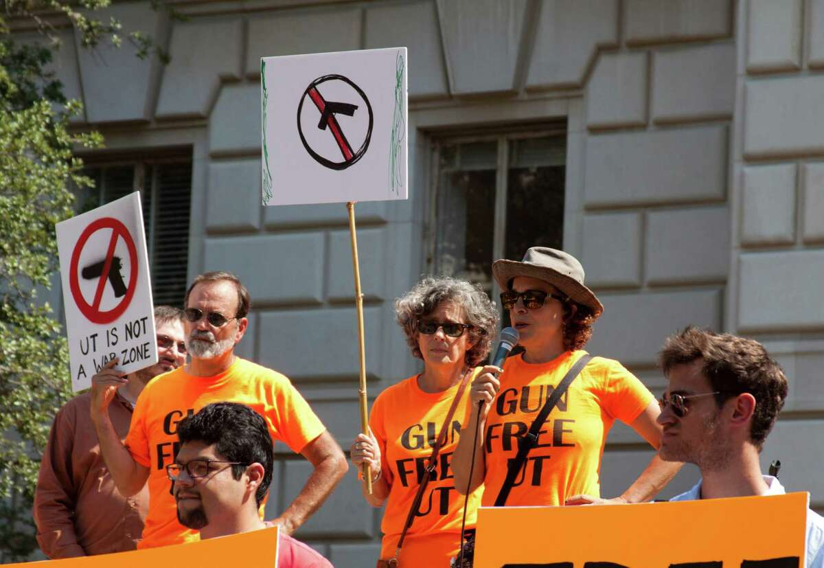 """University of Texas at Austin professors Charters Wynn, Joan Neuberger and Ellen Spiro advocate against campus carry at a protest at the flagship on Wednesday, Sept. 30, 2015. All three have signed a petition against guns in classrooms and are members of the anti-campus carry group """"Gun Free UT."""" (Credit: Mari Correa)"""
