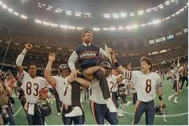 ** FILE ** Chicago Bears head coach Mike Ditka is carried off the field by Steve McMichael, left, and William Perry after the Bears win Super Bowl XX in New Orleans, La., in this Jan. 26, 1986 file photo.  The Bears' Willie Gault (83) and Maury Buford (8) join in celebrating their 46-10 victory over the New England Patriots.  (AP Photo/Phil Sandlin) Ran on: 02-04-2007 Coach Mike Ditka is carried off the field by Steve McMichael (left) and William Perry after the Bears win Super Bowl XX, routing New England 46-10 in New Orleans on Jan. 26, 1986.