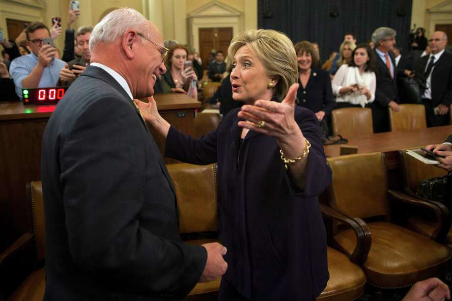 Democratic presidential candidate, former Secretary of State Hillary Rodham Clinton greets Rep. Paul Tonko, D-N.Y. on Capitol Hill in Washington, Thursday, Oct. 22, 2015, during a break in her testimony before the House Benghazi Committee hearing.  (AP Photo/Evan Vucci) ORG XMIT: DCEV202 Photo: Evan Vucci / AP