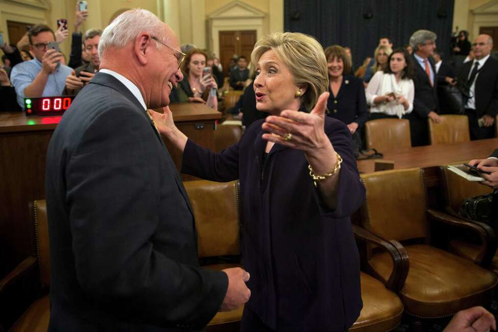 Democratic presidential candidate, former Secretary of State Hillary Rodham Clinton greets Rep. Paul Tonko, D-N.Y. on Capitol Hill in Washington, Thursday, Oct. 22, 2015, during a break in her testimony before the House Benghazi Committee hearing. (AP Photo/Evan Vucci) ORG XMIT: DCEV202