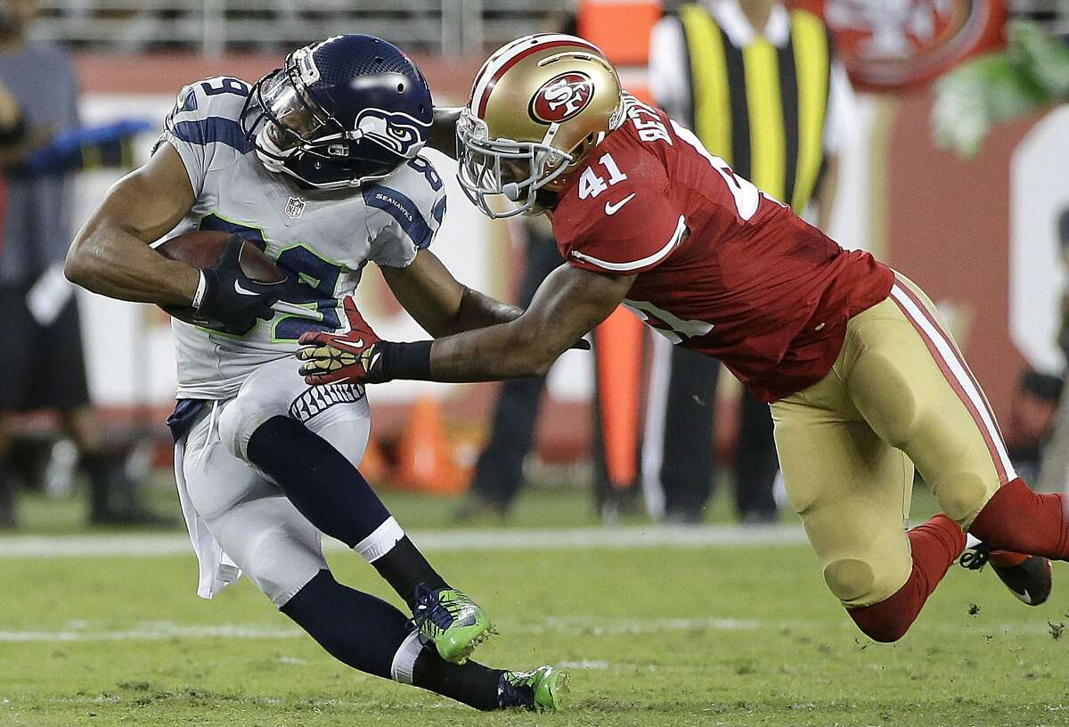 San Francisco 49ers strong safety Antoine Bethea (41) tackles Seattle Seahawks wide receiver Doug Baldwin (89) during the first half of an NFL football game in Santa Clara, Calif., Thursday, Oct. 22, 2015. (AP Photo/Marcio Jose Sanchez)