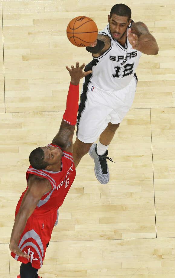 San Antonio Spurs' LaMarcus Aldridge shoots over Houston Rockets' Terrence Jones during first half action Friday Oct. 23, 2015 at the AT&T Center. Photo: Edward A. Ornelas, Staff / San Antonio Express-News / © 2015 San Antonio Express-News