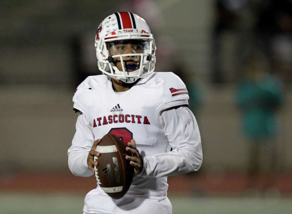 Atascocita's quarterback Daveon Boyd (2) looks for a teammate to pass to in the fourth quarter in game action against Kingwood on Friday, Oct. 23, 2015, in Humble. Atascocita won the game 48-7.