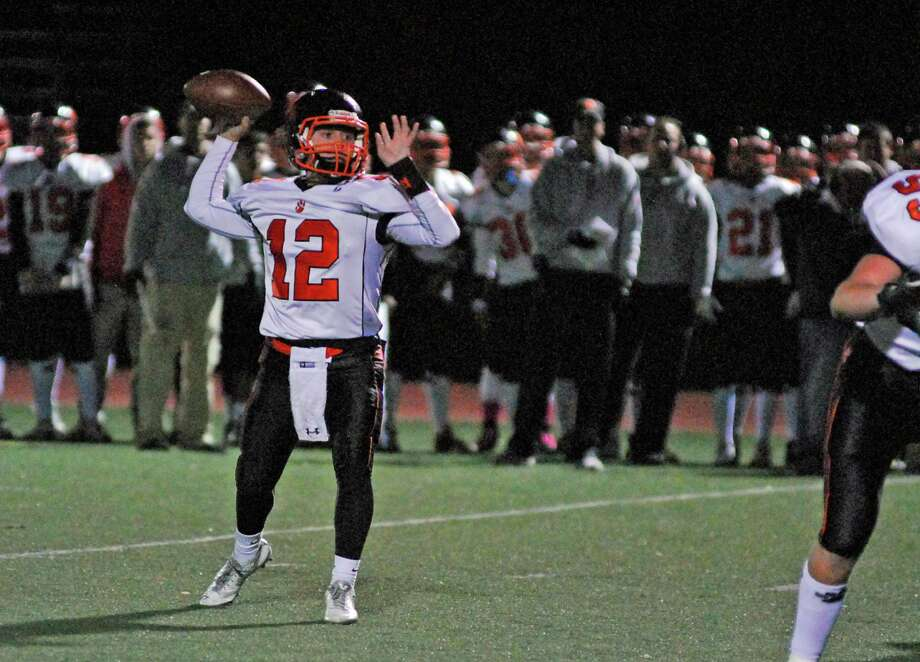 Ridgefield quarterback Drew Fowler throws a pass during a football game against Staples on Friday, October 23rd, 2015 in Westport, Connecticut. Fowler threw four touchdowns as Ridgefield won 31-27. Photo: Ryan Lacey/Staff Photo / Westport News Contributed