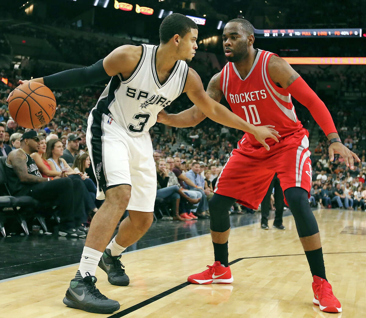 San Antonio Spurs' Ray McCallum looks for room around Houston Rockets' Marcus Thornton during second half action Friday Oct. 23, 2015 at the AT&T Center. The Spurs won 111-86.
