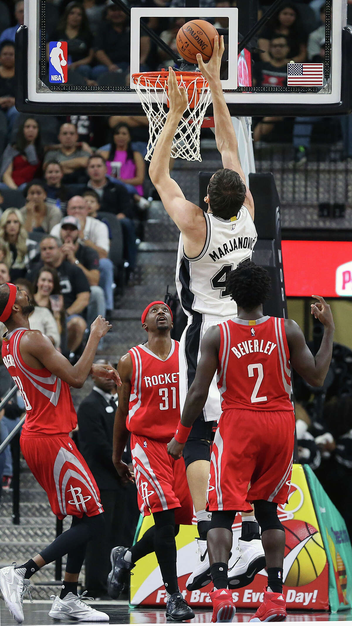 Boban Marjanovic skies above the defense to lay in a bucket as the Spurs host the Rockets at the AT&T Center on October 23, 2015.