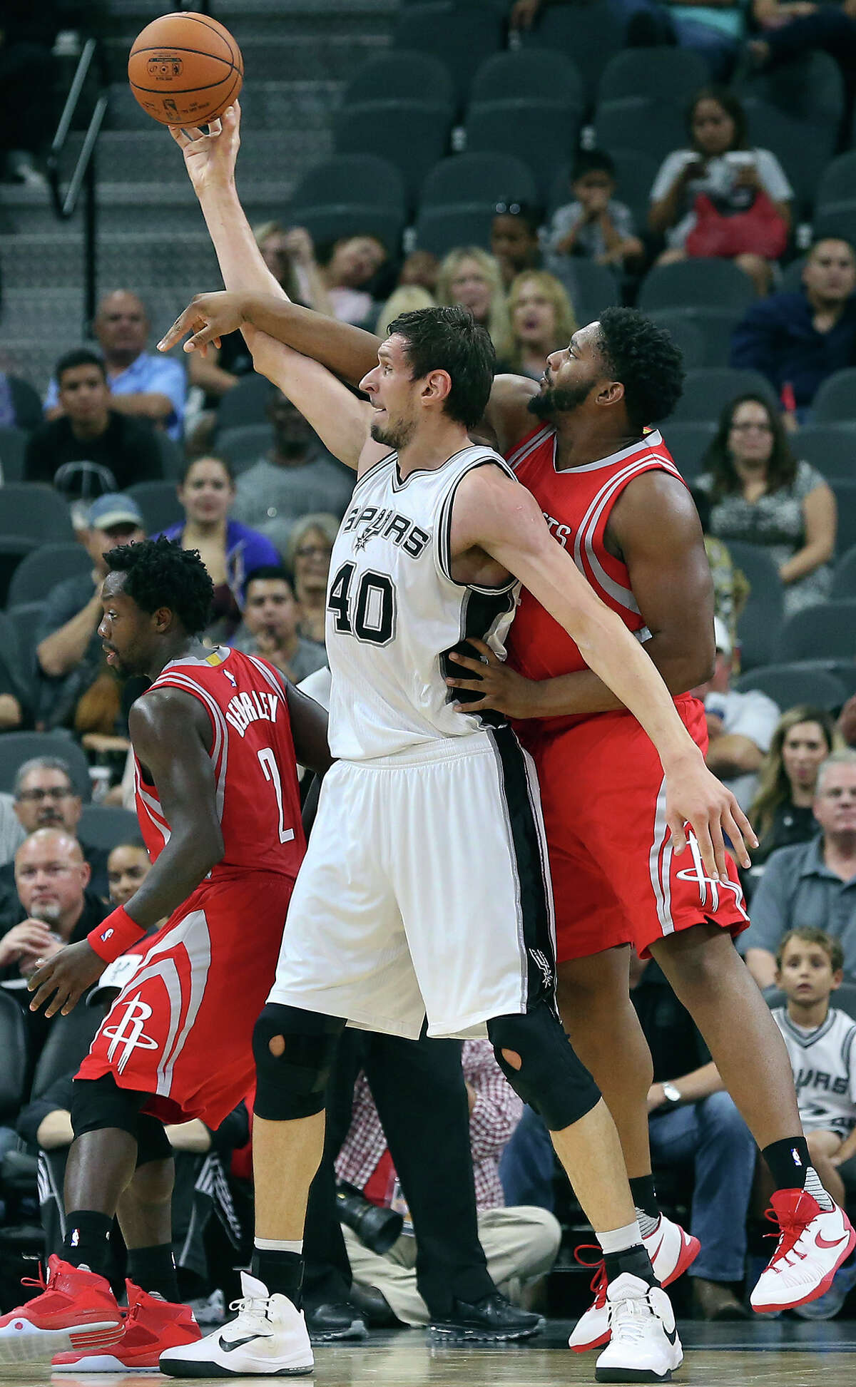 Boban Marjanovic posts up on Joshua Smith as the Spurs host the Rockets at the AT&T Center on October 23, 2015.