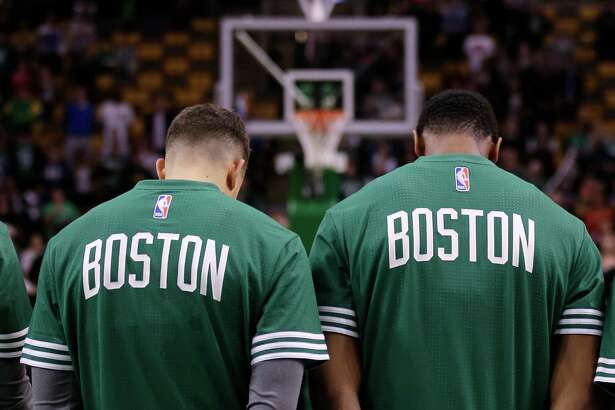 The Boston Celtics line up for the national anthem prior to an NBA preseason basketball game in Boston, Monday, Oct. 19, 2015. (AP Photo/Charles Krupa)