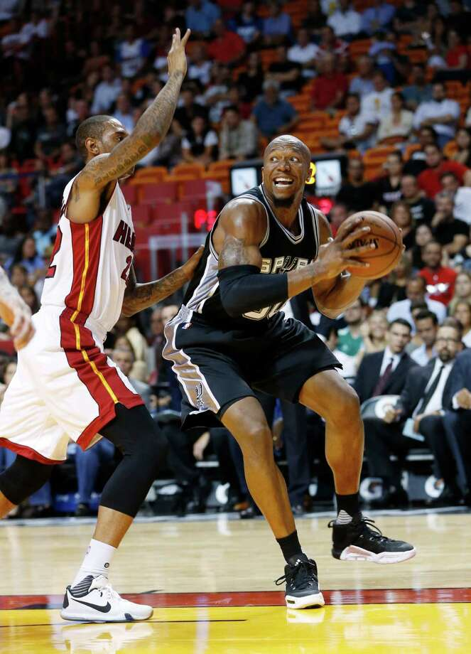 San Antonio Spurs forward David West, right, goes up for a shot against Miami Heat forward Greg Whittington, during the first half of a preseason NBA basketball game, Monday, Oct. 12, 2015, in Miami. Photo: Wilfredo Lee /Associated Press / AP