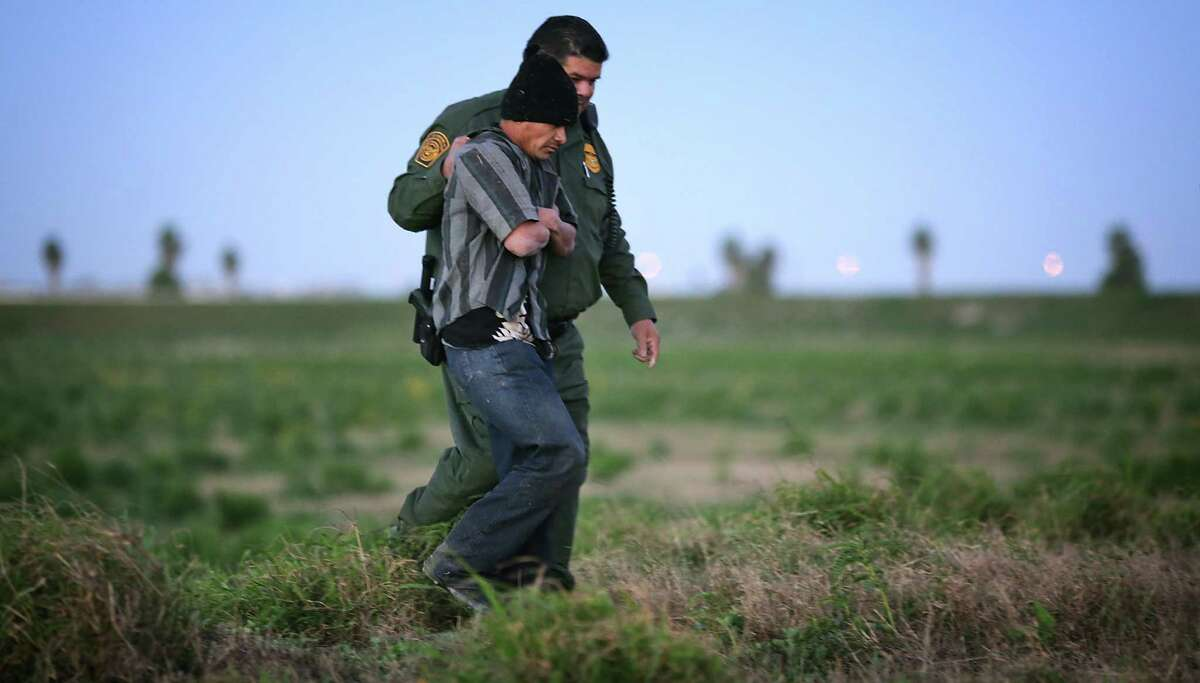 A Border Patrol officer keeps a grip on an un- documented immigrant from Guate- mala near Weslaco. A Border Patrol union official in McAllen testified that President Barack Obama's immigration policies encourage illegal immigration.