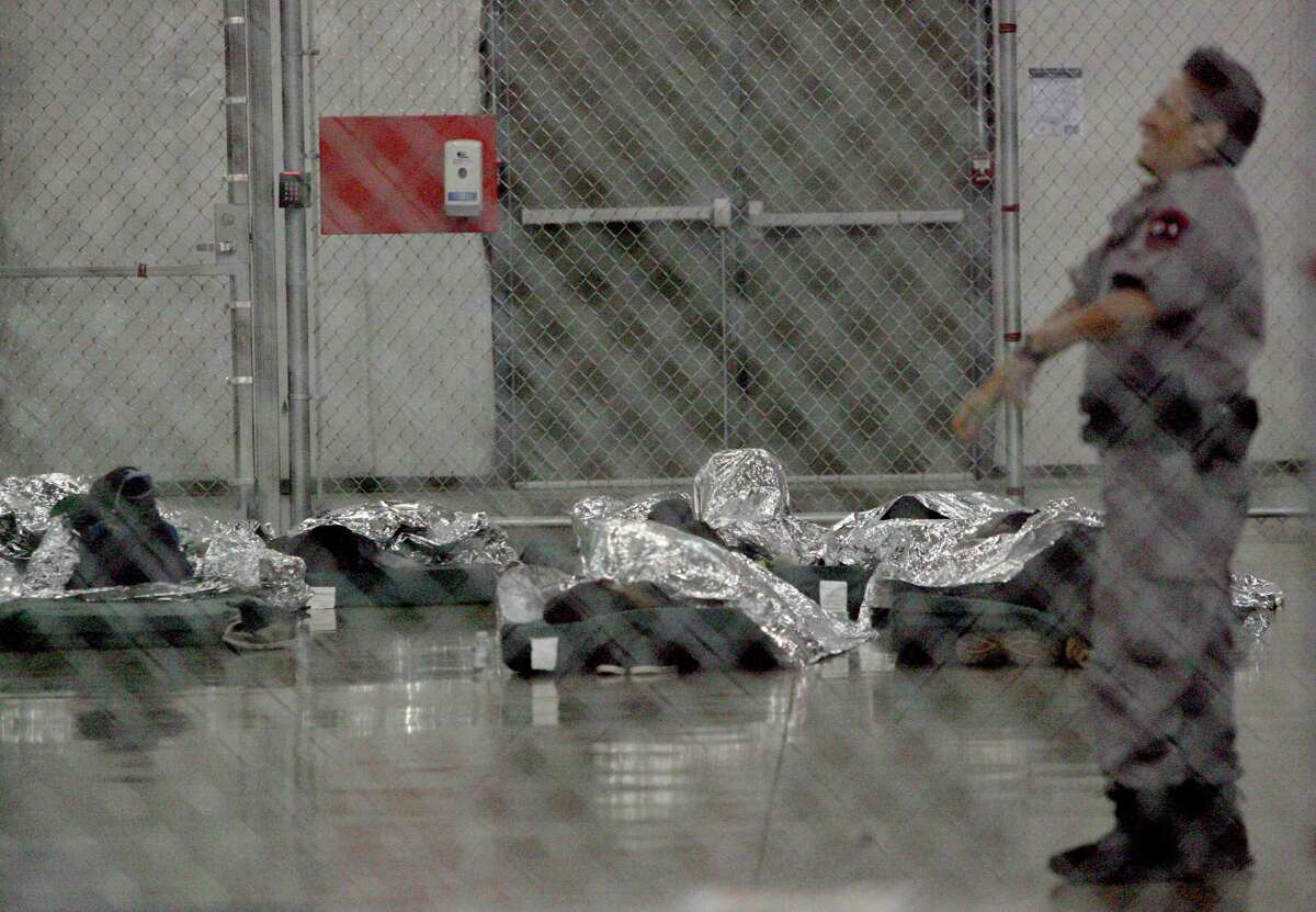 MCALLEN,Tx-Immigrants who were recently apprehended sleep on floor mats Wednesday Aug. 26. 2015 at the US Border Patrol Processing Center in McAllen . Photo by Delcia Lopez dlopez@themonitor.com