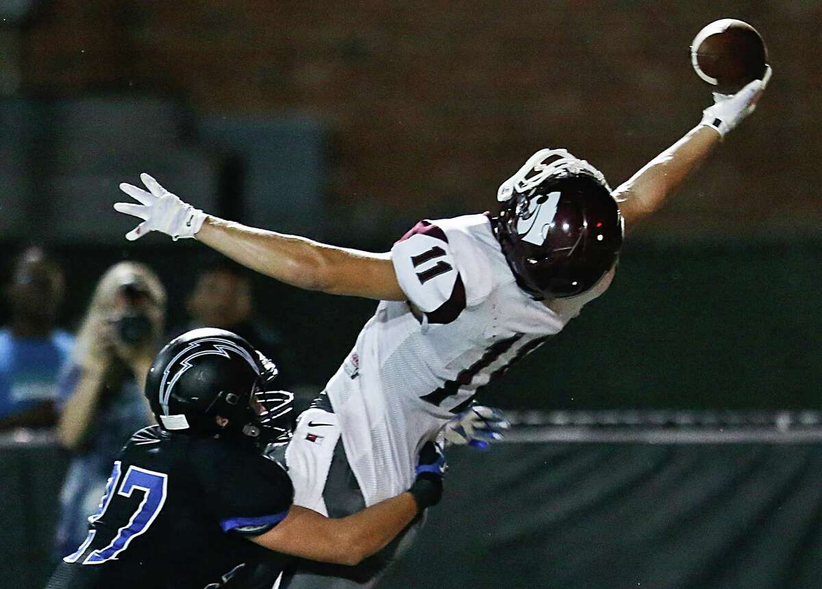 Clear Creek wide receiver Landon Etzel (11) makes a gallant try but can't hang on to a pass while being defended by Clear Springs' Blake Tessitore in the first half of Friday night's District 24-6A game at CCISD Veterans Memorial Stadium. Clear Creek won 49-34.