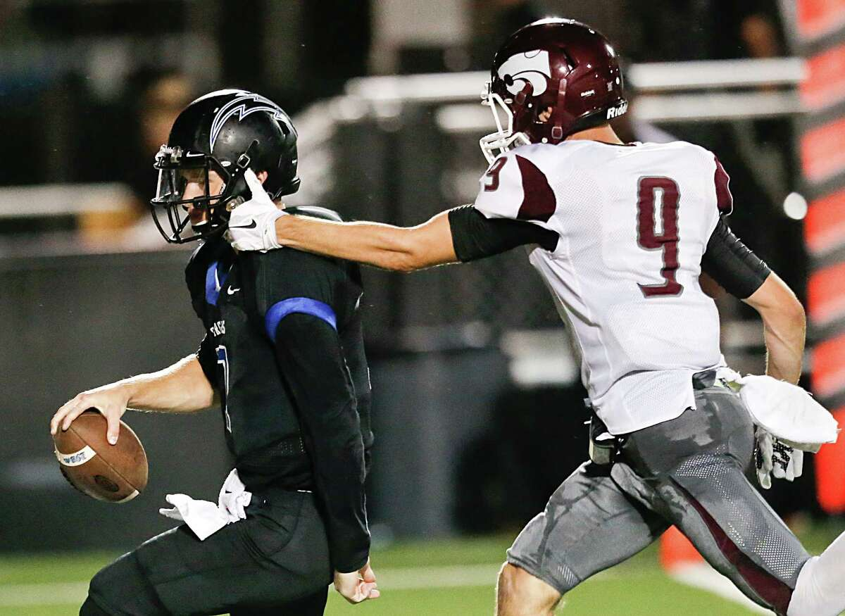 Clear Creek's Earnest Thomas (9) can't quite collar Clear Springs quarterback William McBride, who scores on a 15-yard run in the first half Friday night.