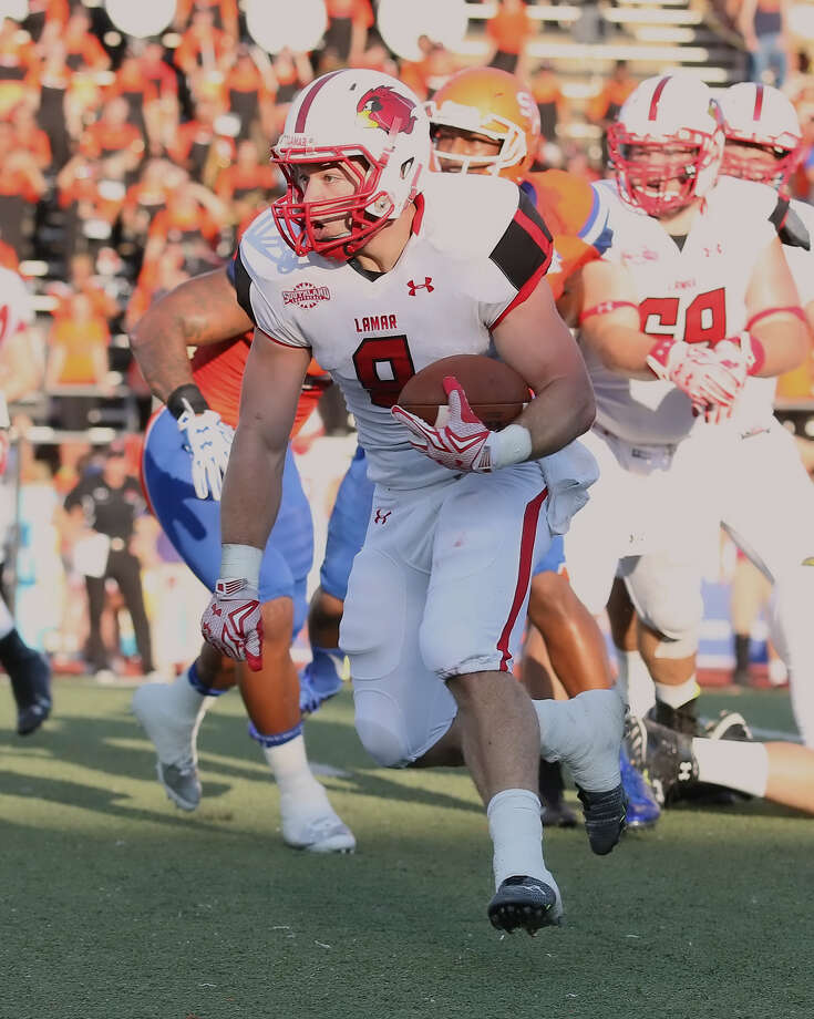 Kade Harrington, 8, runs through the Bearkat defense during the game between the Lamar Cardinals and the Sam Houston State Bearkats at Bowers Stadium in Huntsville, Saturday night, September 19th, 2015 - photo provided by Kyle Ezell