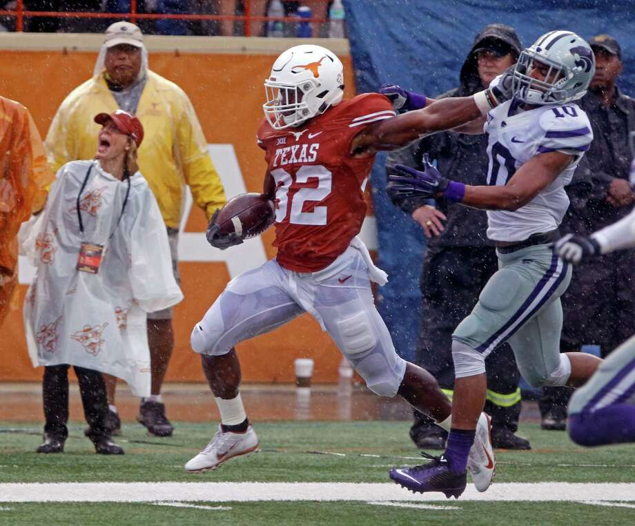 Texas running back Johnathan Gray (32) runs the ball against Kansas State defensive back Donnie Starks (10) during the first half of an NCAA college football game, Saturday, Oct. 24, 2015, in Austin, Texas. (AP Photo/Michael Thomas) Photo: Michael Thomas, Associated Press / FR65778 AP