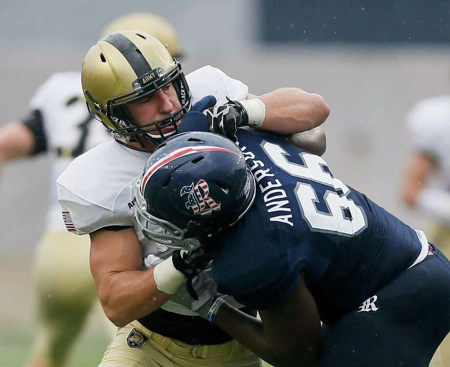 HOUSTON, TX - OCTOBER 24:  Calvin Anderson #66 of the Rice Owls locks up with Brandon Jackson #28 of the Army Black Knights at Rice Stadium on October 24, 2015 in Houston, Texas. Photo: Bob Levey, Getty Images / 2015 Getty Images