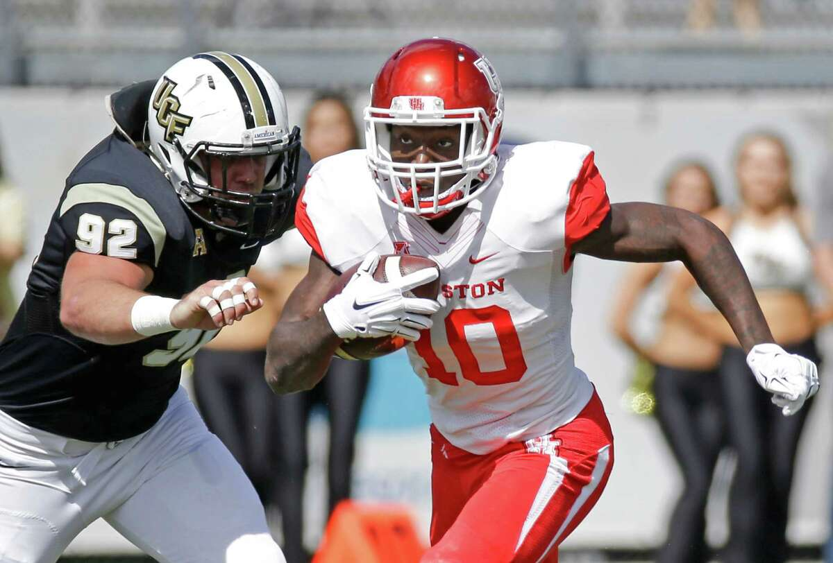 Houston wide receiver Demarcus Ayers (10) runs for yardage against Central Florida defensive lineman Luke Adams (92) during the first half of an NCAA college football game, Saturday, Oct. 24, 2015, in Orlando, Fla. (AP Photo/John Raoux)