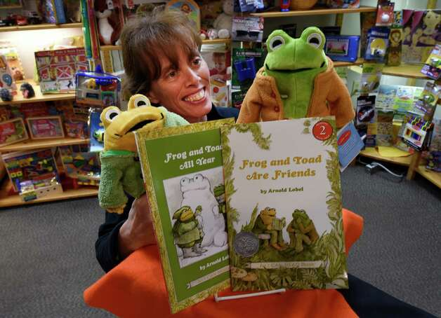 Kathleen Kemp holds Frog and Toad dolls from the popular series of children's books at the Open Door Bookstore Friday morning in Schenectady. The author of the books was from Schenectady. (Skip Dickstein/Times Union) Photo: SKIP DICKSTEIN / 10033903A