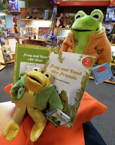 Frog and Toad dolls and books from the popular children's series were on display at the Open Door Bookstore Friday morning. The books, written in the 1970s by Arthur Lobel, who grew up in Schenectady, remain popular. (Skip Dickstein/Times Union) Photo: SKIP DICKSTEIN / 10033903A