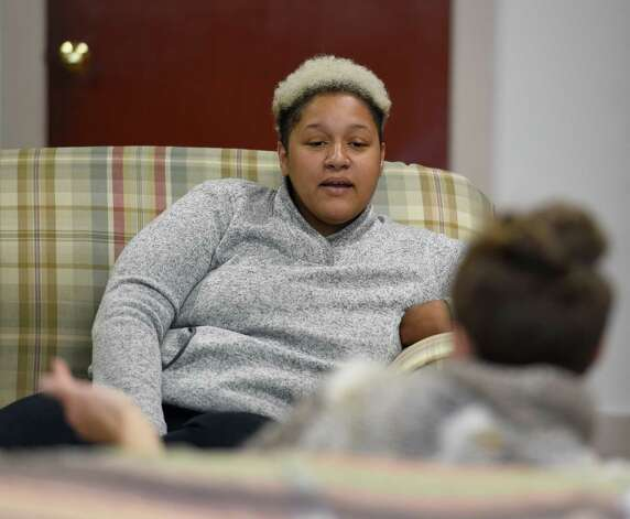 Angelica Clarke, executive director of the Social Justice Center, speaks with a visitor at her office Friday afternoon, Oct. 2, 2015, in Albany, N.Y.   (Skip Dickstein/Times Union) Photo: SKIP DICKSTEIN / 10033601A