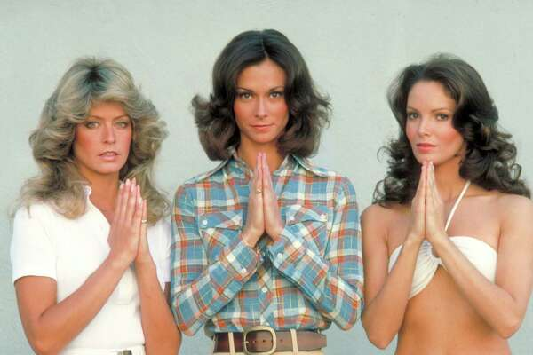"UNITED STATES - SEPTEMBER 22:  CHARLIE'S ANGELS - Pilot - Season One - 9/22/76 Pictured, from left: Farrah Fawcett-Majors, Kate Jackson and Jaclyn Smith played undercover detectives Jill Munroe, Sabrina Duncan and Kelly Garrett of the Charles Townsend Detective Agency. The three, affectionately called ""Angels"" by their unseen-but-heard-over-speakerphone boss Charlie Townsend (the voice of John Forsythe), received work assignments from him and office-based John Bosley (played by David Doyle)."