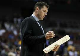 Golden State Warriors interim head coach Luke Walton looks over his notes during the first half of an NBA preseason basketball game against the Los Angeles Lakers in Anaheim, Calif., Thursday, Oct. 22, 2015. (AP Photo/Alex Gallardo)