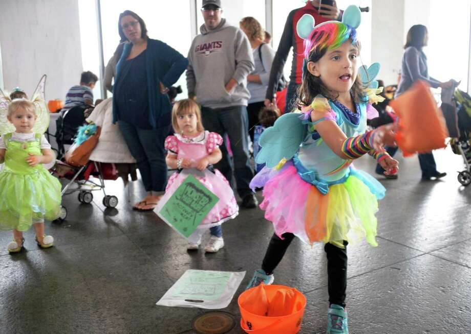 Six-year-old Kylie Shannon of Rotterdam plays a bean bag toss game at the Monster Mash and Bash at the New York State Museum Saturday Oct. 24, 2015 in Albany, NY.  (John Carl D'Annibale / Times Union) Photo: John Carl D'Annibale / 10033902A