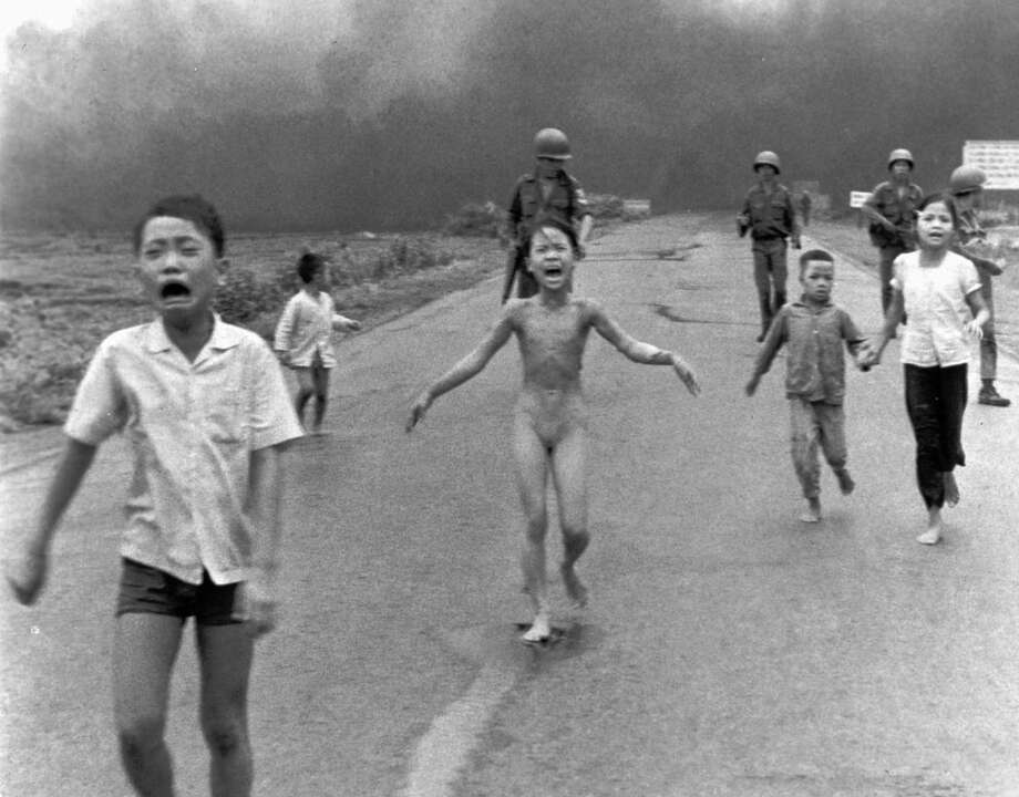 A group of terrified children, including 9-year-old Kim Phuc as they flee after an accidental aerial napalm attack on Trang Bang, South Vietnam. Photo: Photos By Nick Ut /Associated Press / AP