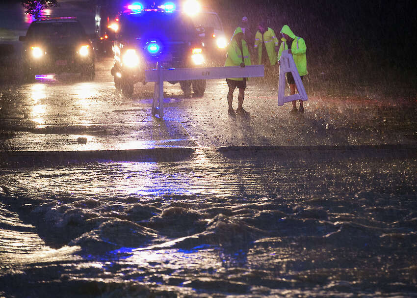 Austin Fire Department rescue personnel secure a low water crossing entrance over Williamson Creek, Saturday, Oct. 24, 2015, in Austin, Texas. A powerful storm system moved through Texas on Saturday, flooding roads and causing a freight train to derail as parts of the state braced for the remnants of Hurricane Patricia to arrive. (Ralph Barrera/Austin American-Statesman via AP) AUSTIN CHRONICLE OUT, COMMUNITY IMPACT OUT, INTERNET AND TV MUST CREDIT PHOTOGRAPHER AND STATESMAN.COM, MAGS OUT; MANDATORY CREDIT