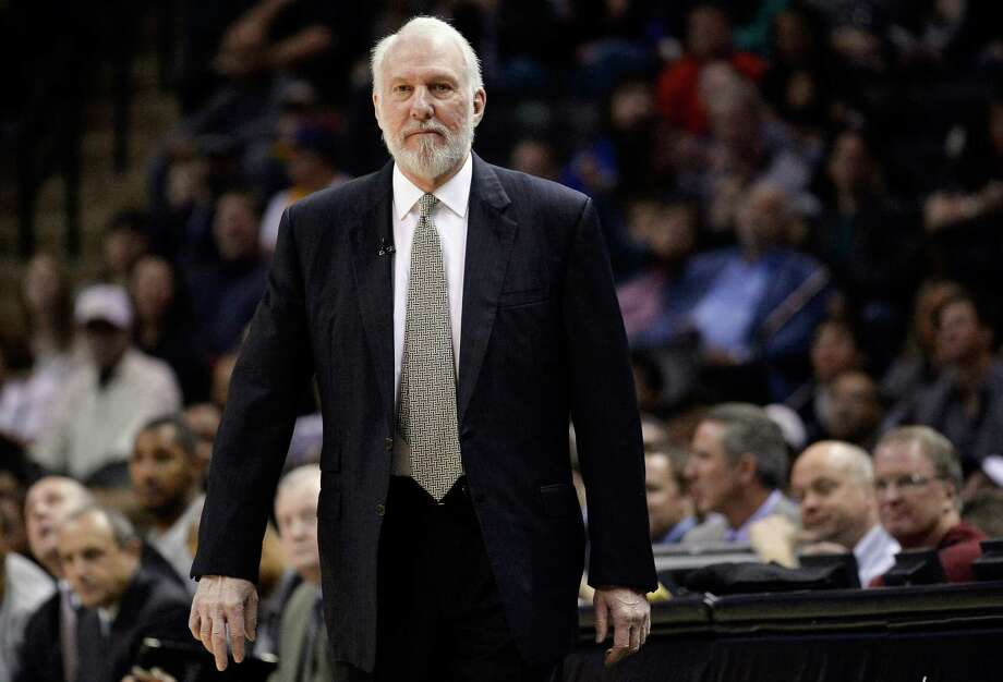 FILE - This is a March 8, 2015, file photo showing San Antonio Spurs head coach Gregg Popovich watching play during the first half of an NBA basketball game against the Chicago Bulls in San Antonio. Popovich, who has led the San Antonio Spurs to five NBA titles, will replace Mike Krzyzewski as the U.S. basketball coach following the 2016 Olympics.  (AP Photo/Darren Abate, File) Photo: Darren Abate, FRE / Associated Press / FR115 AP