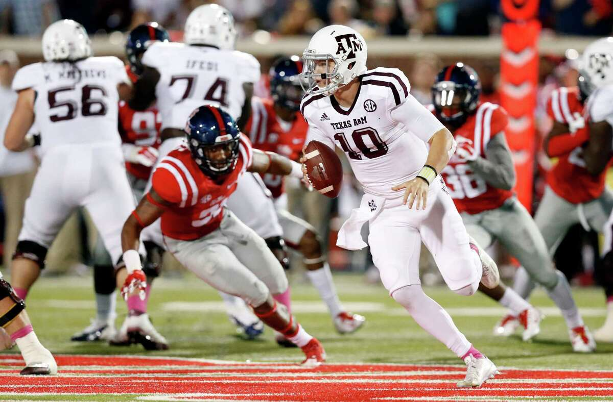 Texas A&M quarterback Kyle Allen (10) scrambles for a short gain while being pursued by Mississippi defenders during the first half of an NCAA college football game in Oxford, Miss., Saturday, Oct. 24, 2015. (AP Photo/Rogelio V. Solis)
