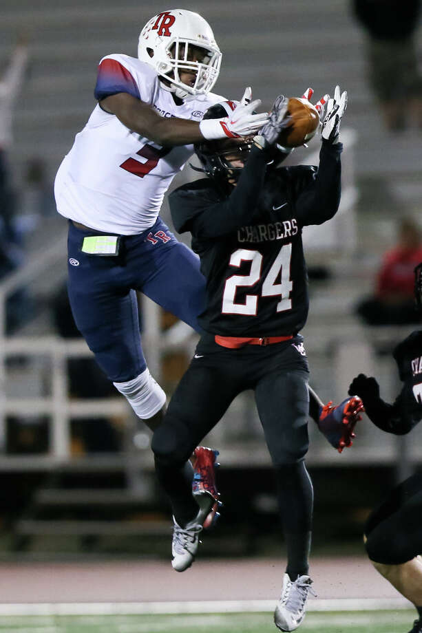 Churchill's Trevor Divel (right) intercepts a pass intended for Roosevelt's Abideen Bello during the first half of their District 26-6A game at Comalander Stadium on Saturday, Oct. 24, 2015. MARVIN PFEIFFER/ mpfeiffer@express-news.net Photo: Marvin Pfeiffer, Staff / San Antonio Express-News / Express-News 2015