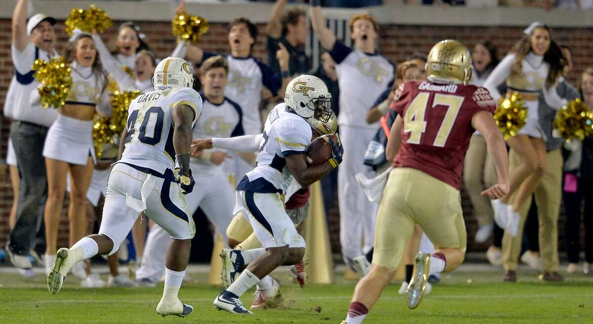 Georgia Tech defensive back Lance Austin, middle, returns a blocked field goal for a touchdown on the final play of the game to upset Florida State, 22-16, at Bobby Dodd Stadium in Atlanta on Saturday, Oct. 24, 2015. (Brant Sanderlin/Atlanta Journal-Constitution/TNS)