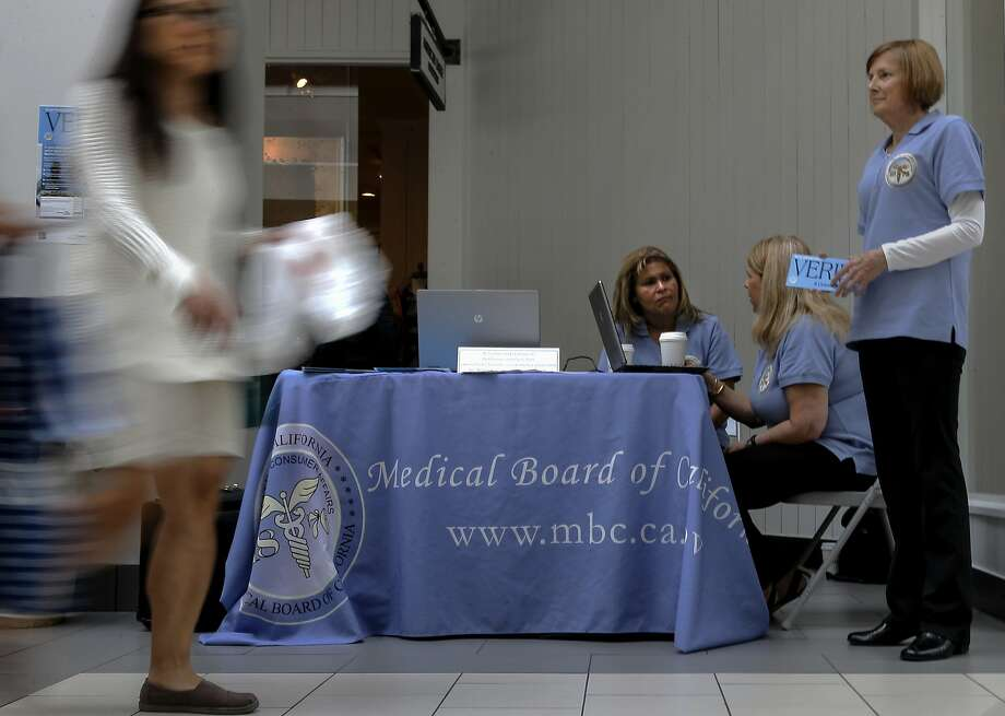 Frances Garcia (left), Casandra Hockenson and Lois Ranftle, representatives of the Medical Board of California, participate in an outreach event at the Arden Fair Mall in Sacramento, showing residents how they can access information about whether their medical doctor is in good standing with the state. Photo: Michael Macor, The Chronicle
