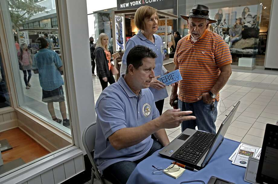 Mike Walker and Lois Ranftle representatives with the Medical Board of California meet with Jack Gonzales, (right) of Sacramento during an outreach at the Arden Mall in Sacramento, Calif. on Sat. October 24, 2015, showing the public how they can access information about whether or not their medical doctor is in good standing with the state, the data showed his physician was just fine. Photo: Michael Macor, The Chronicle