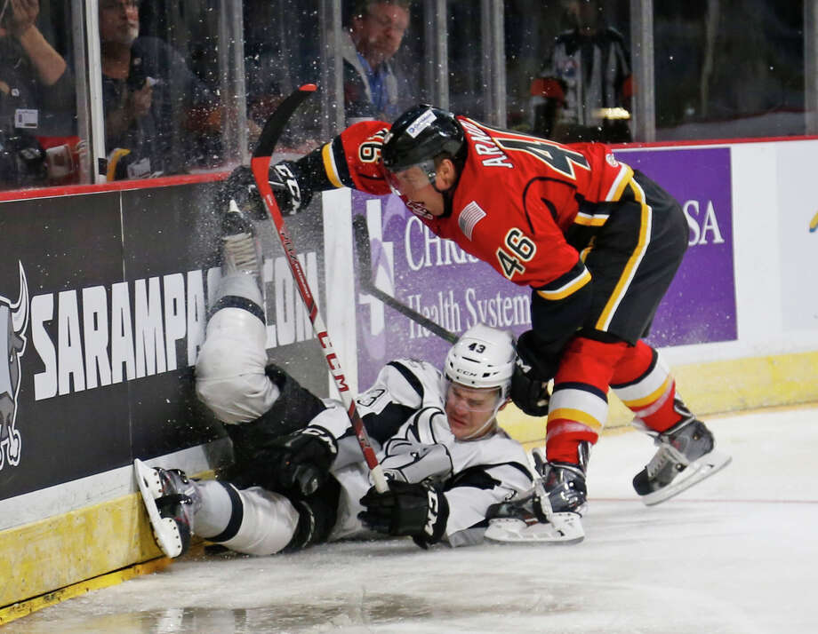 Rampage's Mat Clark battles Stockton's Bill Arnold for possession of the puck in the first period in American Hockey League home opener for San Antonio on Saturday, October 24, 2015. Photo: Ron Cortes, Freelancer / For The San Antonio / Express-News