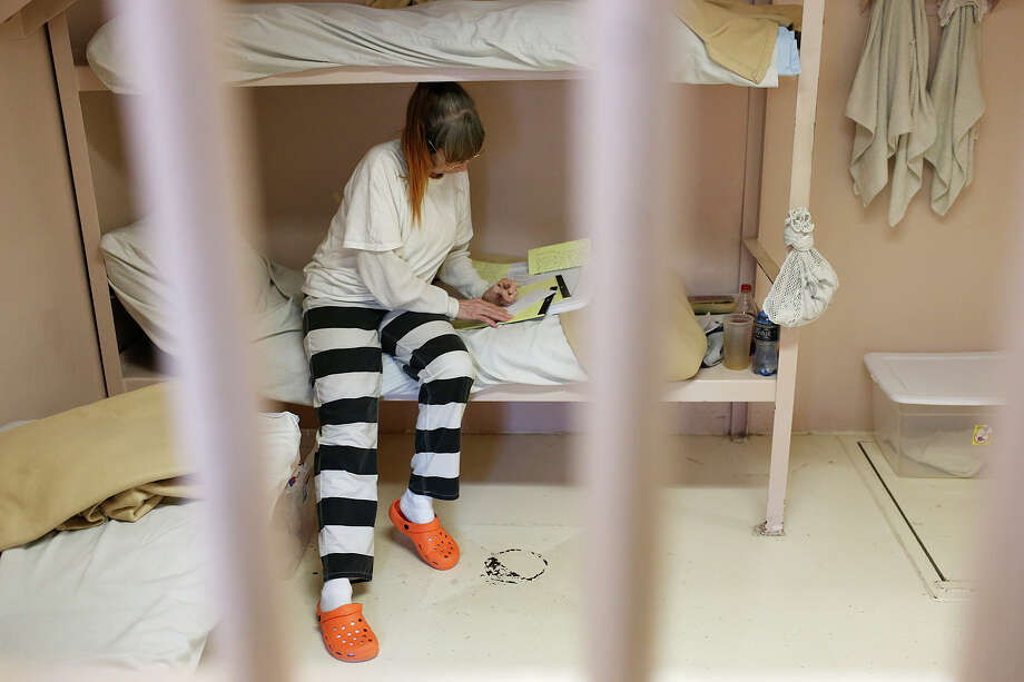 Kathryn Turner writes a letter to her son while in a cell she shares with two other inmates at the Kendall County Jail in Boerne. Voters in Comal and Kendall counties will cast ballots Nov. 3 on bond propositions to build new jails and sheriff offices. Photo: Photos By Jerry Lara /San Antonio Express-News / © 2015 San Antonio Express-News