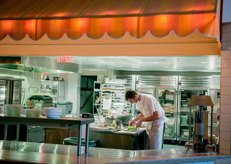 The kitchen under a colorful awning at Bon Marche on Market Street in S.F. Photo: John Storey, Special To The Chronicle